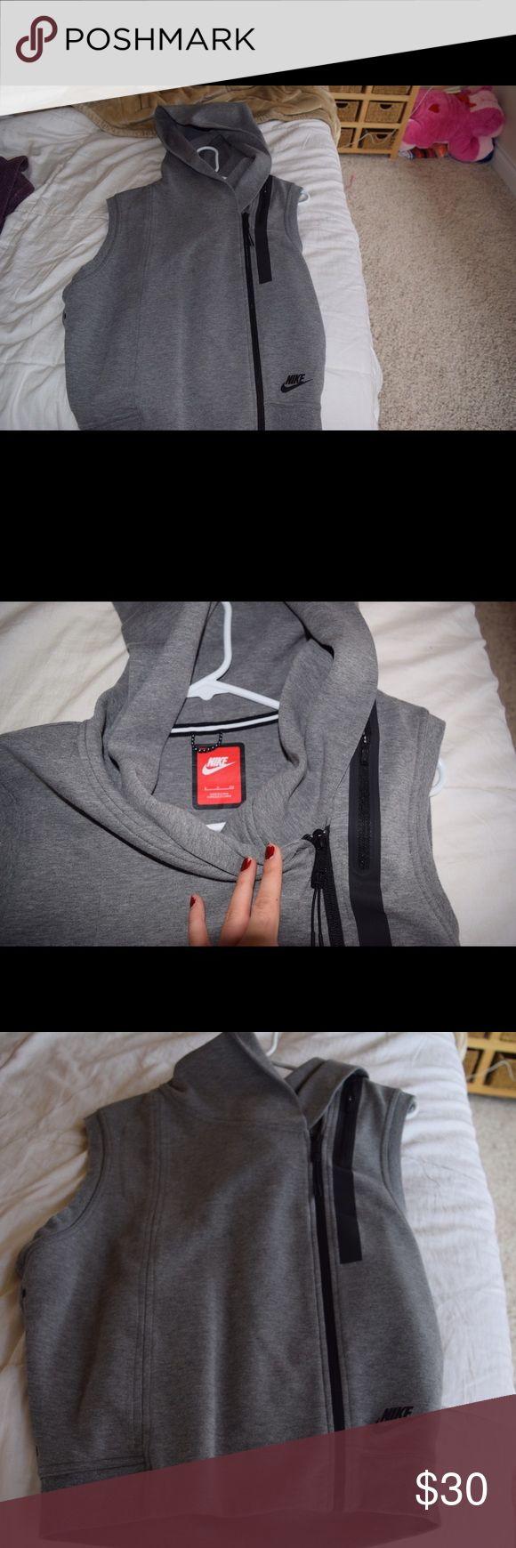 Nike vest Grey Nike vest. Super comfy and cute to workout in or regularly wear. Nike Jackets & Coats Vests