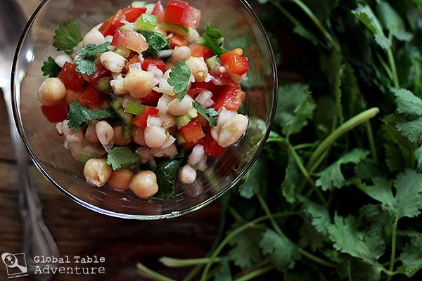 Pakistani Mixed Bean Salad. Each bite has bits of chickpea, northern white beans, tomato, onion, and peppers. The salad can be spicy or mild, tart or savory