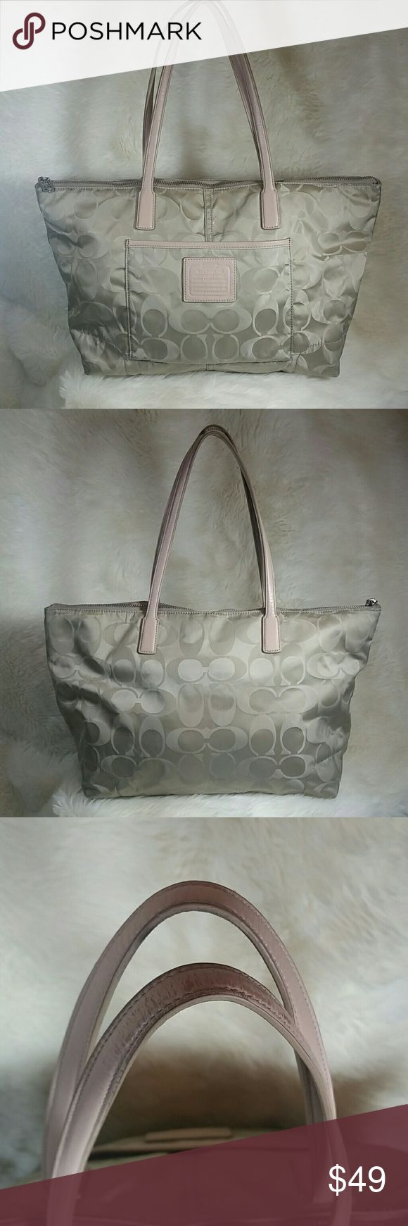 """Coach Legacy Signature Weekend Nylon Tote 24862 Coach Legacy Signature Weekend Nylon Tote. Coach creed #G1376-24762. Tan pearl sheen signature print. Tan leather handles show color rub. Full zip top closure. Interior has minor spotting and exterior has minor spotting with the majority being on the bottom. No corner wear. Zipper works perfectly. Inside zip pocket with 2 open pockets on opposite side.   17"""" long 10.5"""" tall 6"""" wide  9"""" strap drop Coach Bags Totes"""