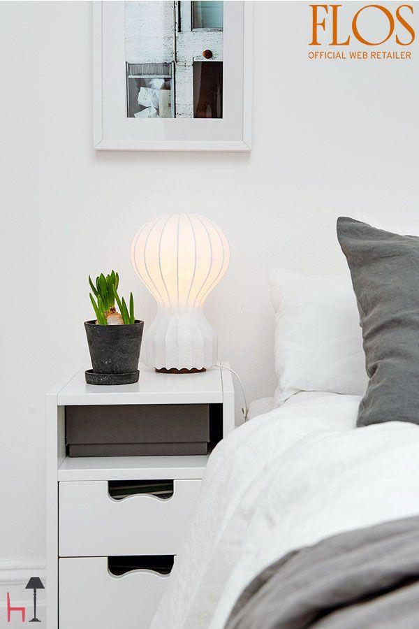 Gatto Piccolo is a diffused light table lamp designed by Achille and Pier Giacomo Castiglioni for Flos .