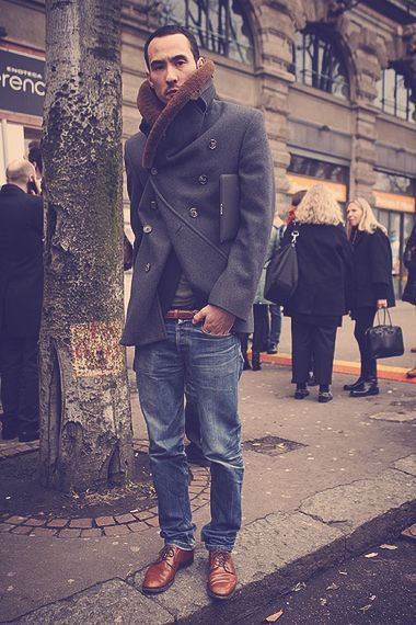 Something as simple as teaming a charcoal fur collar coat with dark blue jeans can potentially set you apart from the crowd. Dress up your getup with brown leather derby shoes.   Shop this look on Lookastic: https://lookastic.com/men/looks/charcoal-fur-collar-coat-navy-jeans-brown-derby-shoes-dark-brown-belt/3794   — Brown Leather Derby Shoes  — Navy Jeans  — Dark Brown Leather Belt  — Charcoal Fur Collar Coat
