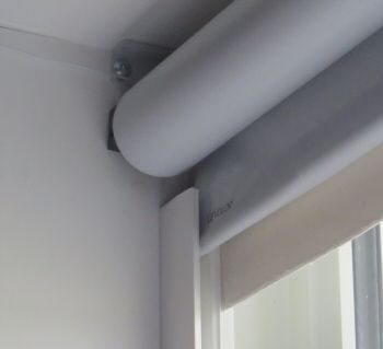 U-Channel from the hardware to block the light either side of a roller blind
