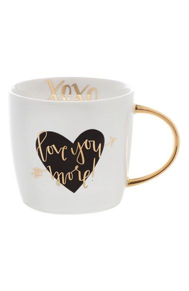 Treat your loved one with a ceramic mug stamped with the announcement, 'Love you more.' The interior seals the deal with some hugs and kisses.