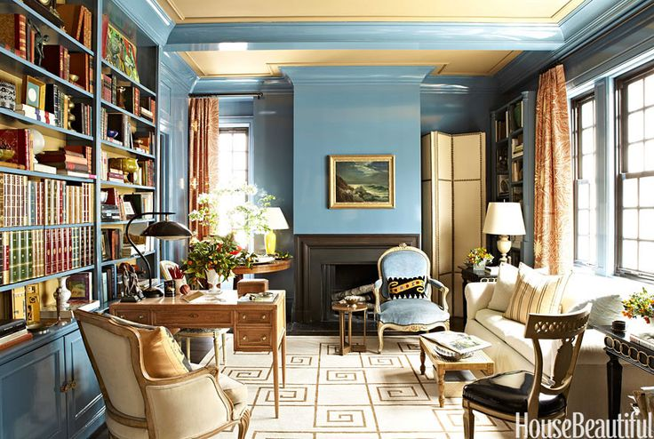 Garrow Kedigian - The library in Garrow Kedigian's Manhattan apartment.  A vibrant custom palette in a Fine Paints of Europe Brilliant finish.  Curtains of Clarence House Elettra flank a sofa in Scalamandre's Variegation herringbone.  A Louis XV fauteuil (a gift from Kedigian's grandmother) retains it's original blue velvet, and a neoclassical side chair is updated with Giant Squid Leather.
