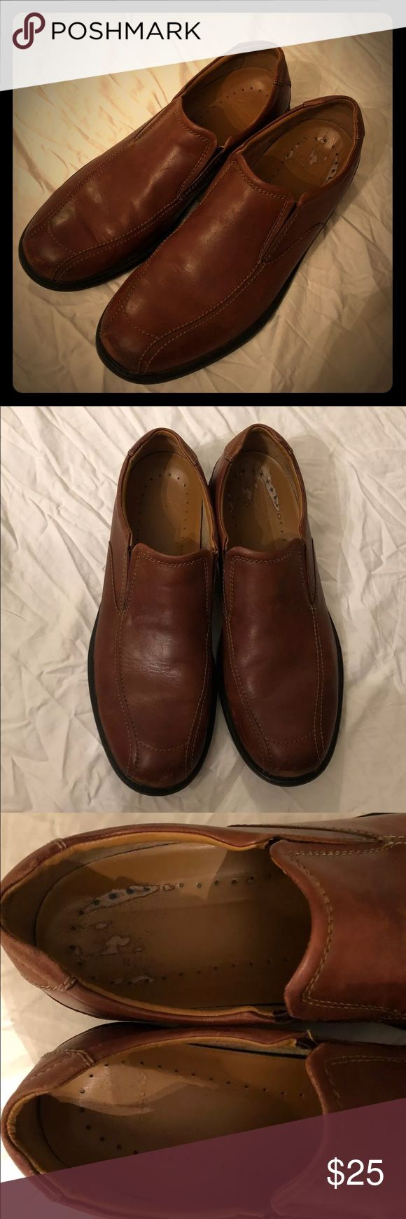 Men's Slip on Clark's Brown leather slip on Clark's.  Has wear and tear. In good condition.  Size 12 Clarks Shoes Loafers & Slip-Ons