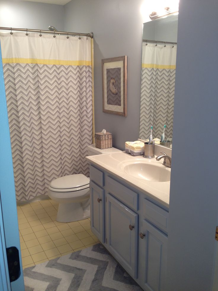 chevron bathroom grey bathrooms yellow accent walls yellow accents