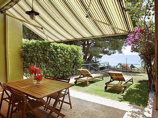 in Santa Margherita di Pula: 1 Schlafzimmer, für bis zu 4 Personen. Pinus Village Apartment mit einem Schlafzimmer in der zweiten Reihe am Meer, 2 Flug vom Strand | FeWo-direkt