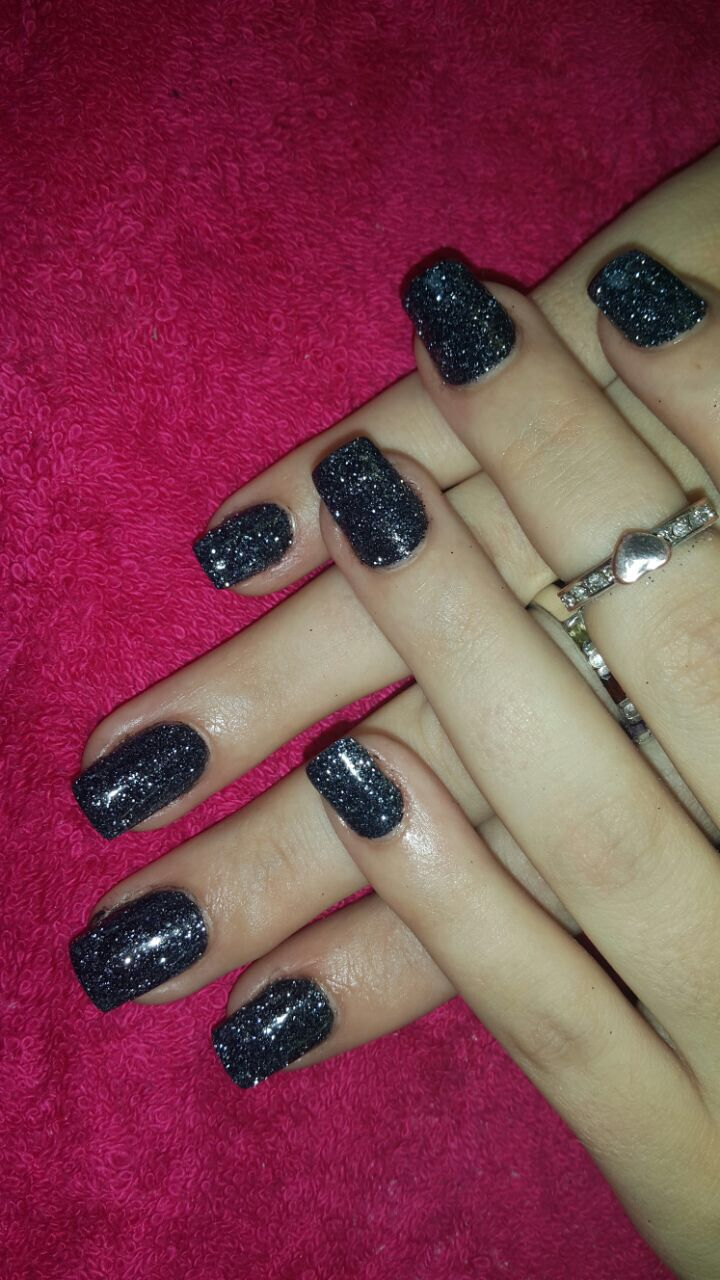 Black glitter nail art.