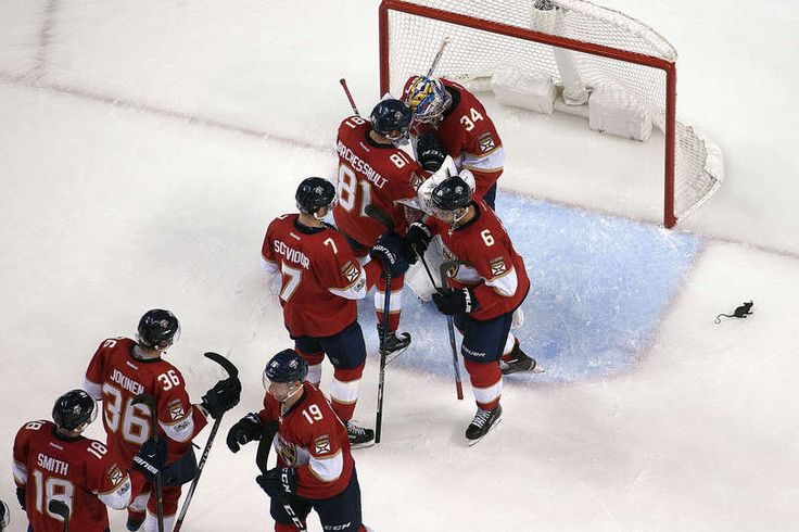SUNRISE, FL - MARCH 25: The Florida Panthers celebrate their 7-0 win over the Chicago Blackhawks at the BB&T Center on March 25, 2017 in Sunrise, Florida. (Photo by Eliot J. Schechter/NHLI via Getty Images)