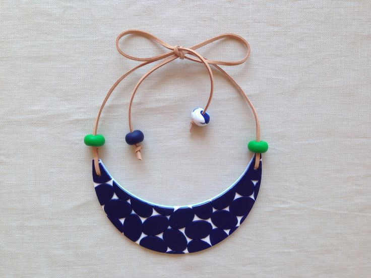Mary Ted Creative - Handmade necklace in clay with elliptical pattern and leather strap. The all clay beads in a contrasting colour complete the look!
