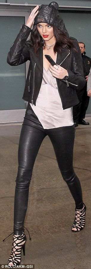 Kendall Jenner and Khloe Kardashian look edgy in leather at LA game  #dailymail