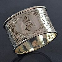 Antique silver Victorian Napkin ring with floral engraving, central cartouche 1890