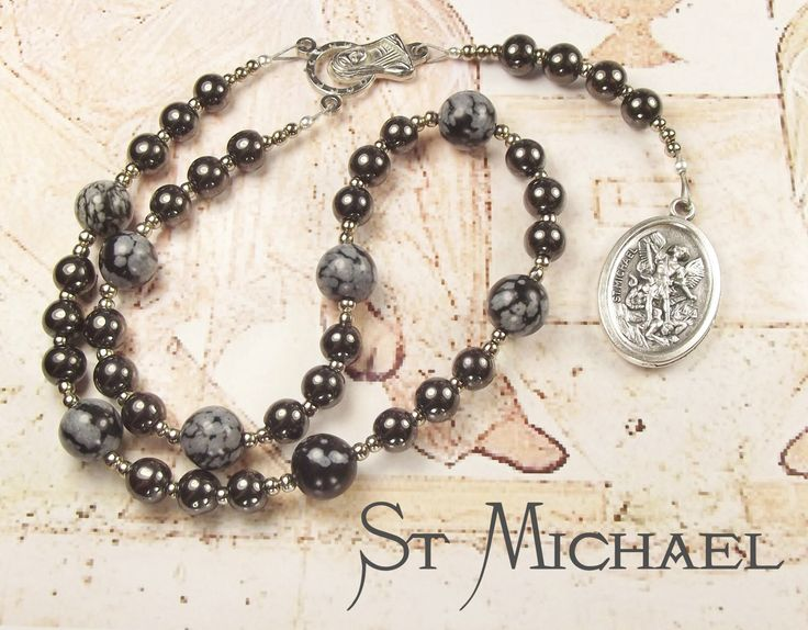 St MICHAEL CHAPLET with Haematite and Snowflake Obsidian beads and St Michael Medal by tiggawild on Etsy https://www.etsy.com/listing/201633244/st-michael-chaplet-with-haematite-and