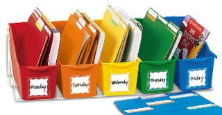 Teacher organization station from LAKESHORE LEARNING.  Store all daily materials in each bin for each day of the week. They come with poly folders for each bin. If absent, the kiddos direct the sub to these bins. Must check out this site for more fantastic classroom management ideas.