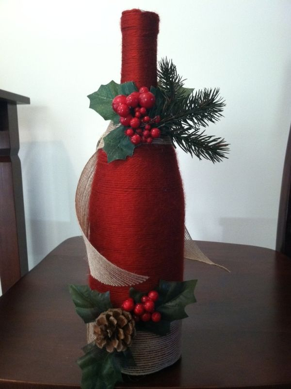 This one is a wine bottle wrapped in yarn with some christmas decor! by debbie.rose.37