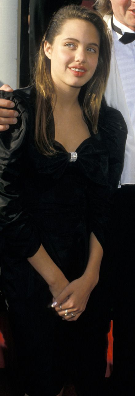 Even Angelina Jolie had an awkward phase!  Angelina at 13 years old (with braces!) at the 1988 Oscars
