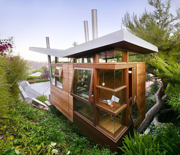 I like the idea of a luxury tree house. this one would make a nice little office.
