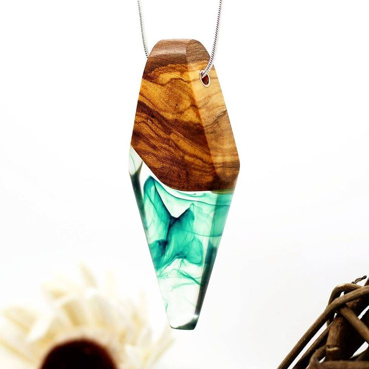 Another green pendant. Triangular olive wood and resin. . lovely green swirled…