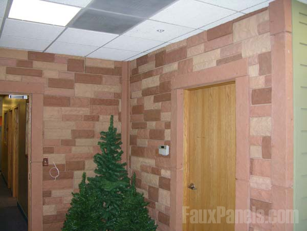 Windsor random rock siding panels are an attractive backdrop for a Christmas tree http://www.fauxpanels.com/img_c/5-windsor/design/int/011.jpg
