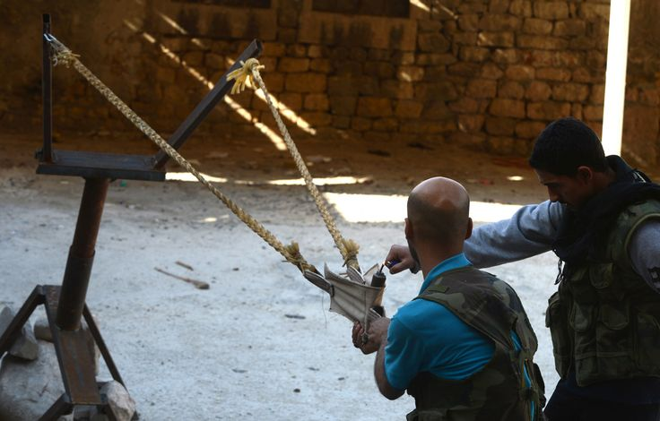 Syrian Rebels - Launching Bomb with Slingshot  2012