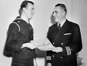 """With his """"Ruptured Duck"""" patch sewn on his navy tunic, William Patrick Hitler receives his US Navy records as he leaves the service in 1947. (US NAVY)"""