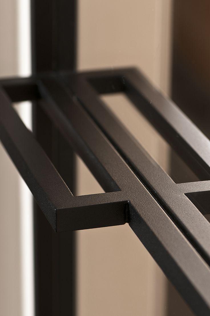 Steel and glass door handle detail by D'Hondt Interieur