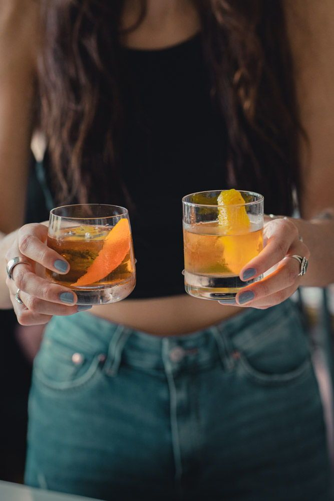 Two classic whiskey cocktails with only one ingredient that sets them apart but creates a distinctively different drink.