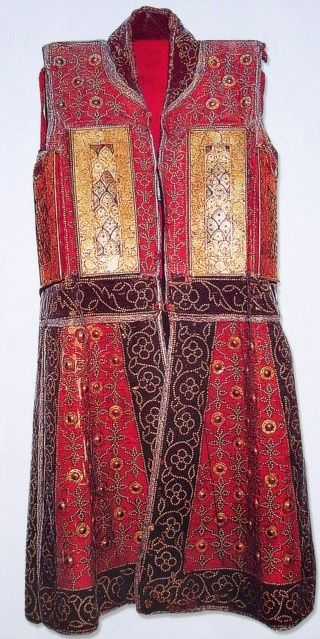 Indian (Rajput) chilta hazar masha (coat of a thousand nails),  Armored clothing made from layers of fabric faced with red velvet and studded with numerous small brass nails, which were often gilded. The padded coat, minus its nails, is known for short as a chilta and was worn over armor or on its own. Fabric armor was very popular in India because metal became very hot under the Indian sun. This example has additional armor (floral plates) plates in the chest area.