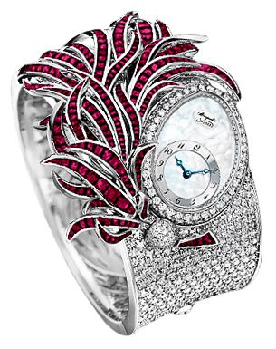 """BREGUET  """"Plumes""""  18k White Gold Watch set with baguette-cut Rubies and with 1200 Diamonds. 18k silvered Gold dial with natural Mother-Of-Pearl overlay. Off-centred chapter ring with Breguet Arabic numerals. Self-winding movement. Winding rotor in 950 platinum, hand engraved on a rose-engine."""