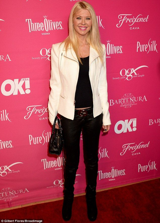 Keeping it casual: Tara Reid dressed down and covered up in a black top, jeans and boots and a cream leather jacket