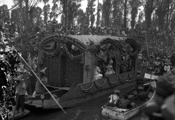 All things Mexico.A trajinera decorated for the celebration of Viernes de Dolores in Santa Anita near 1920. This was one of the most important festivities taken place at the canal. Photo from the INAH archives.