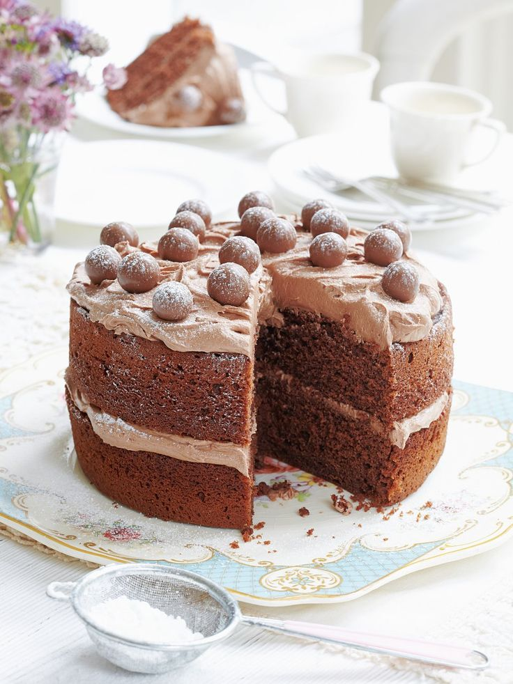 Mary Berry's malted chocolate cake recipe is made with chocolate cake with a malted icing and topped with Maltesers. It's a real crowd-pleaser and family favourite.