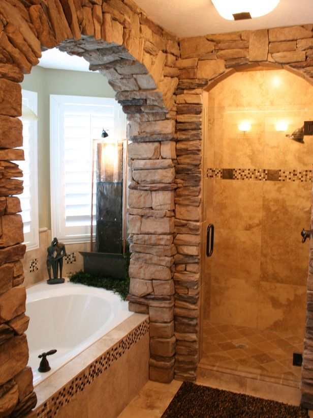 Surrounded by windows, neutral-toned tile and a natural stone archway, this bathtub quickly becomes the best spot in the house. RMS user teach1850 used warm lighting and rustic accessories to turn this master bathroom into a spa-inspired retreat with a vacation feel.