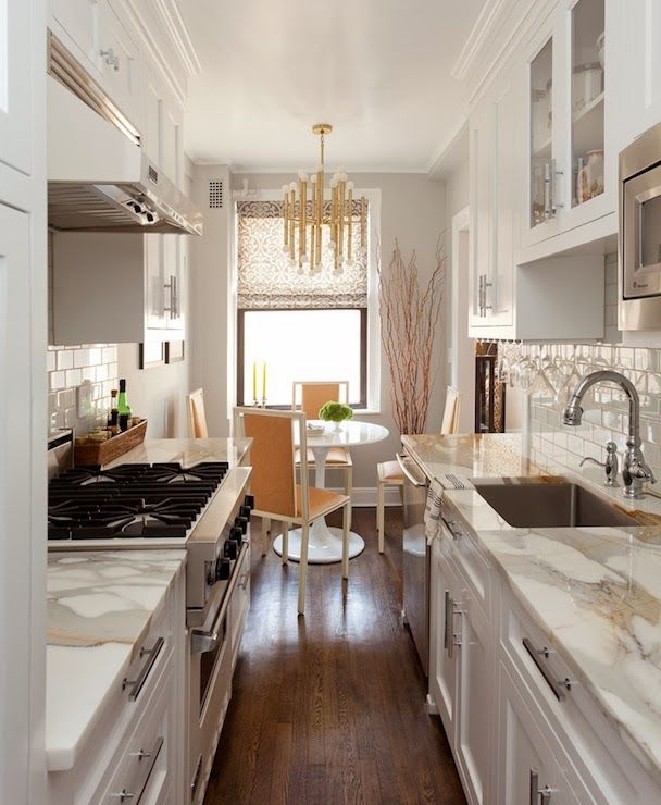 COUNTER TOPS Small Galley Kitchen In NY Apartment Done Very Well. Saarinen  Dining Table, Jonathan Adler Brass Chandelier, Marble Counters, Subway Tile  With ... Part 69