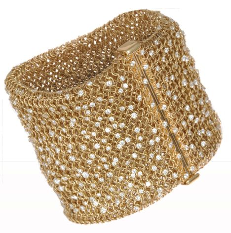 Made by Sidney Garber, it is 18k gold mesh set with just over 20 carats of diamo…