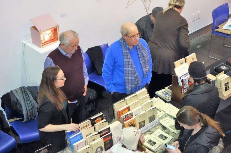 Stephanie Small, Tim Inkster and Tom Smart chat with customers at the OCADU Book Arts Fair, December 10, 2016. Photo by Don McLeod.