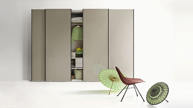 LEMA | TEXT by Officinadesign Lema is characterised by an elegant metal profile. Extremely versatile, it is perfect for custom designs. Here proposed with sliding doors. A sinuous and light form for the WING lounge chair, designed by Werner Aisslinger. WING is a delicate petal in wood, which rests on four metal legs for an elusively vintage look.