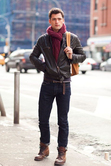 Shop this look for $221:  http://lookastic.com/men/looks/jeans-and-scarf-and-bomber-jacket-and-belt-and-boots/592  — Navy Jeans  — Burgundy Scarf  — Brown Leather Bomber Jacket  — Brown Leather Belt  — Brown Leather Boots