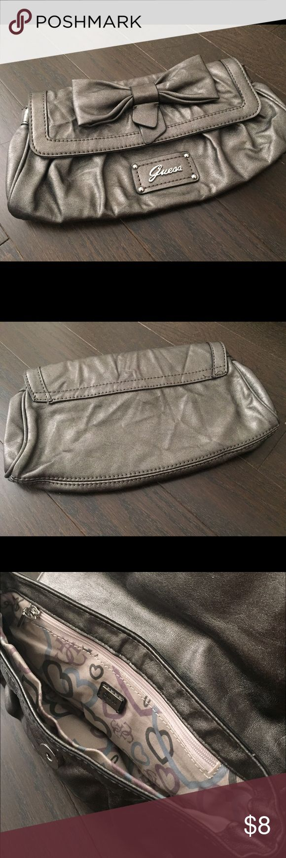 Cute silver grey clutch from GUESS Very cute grey GUESS clutch with bow tie.  Very good condition. No defects at all. Guess Bags Clutches & Wristlets
