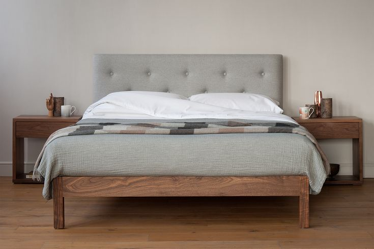 A stylish contemporary bed, with a solid wood frame and an upholstered and buttoned headboard. Made entirely in the UK by our local craftsmen. Buy online.