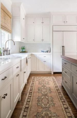 Neutral kitchen with butcher block counter kitchen island, neutral beige and gray Turkish runner rug, all-white kitchen cabinets and granite composite counter tops. Interior design and styling by Jamie Keskin Design. by penelope