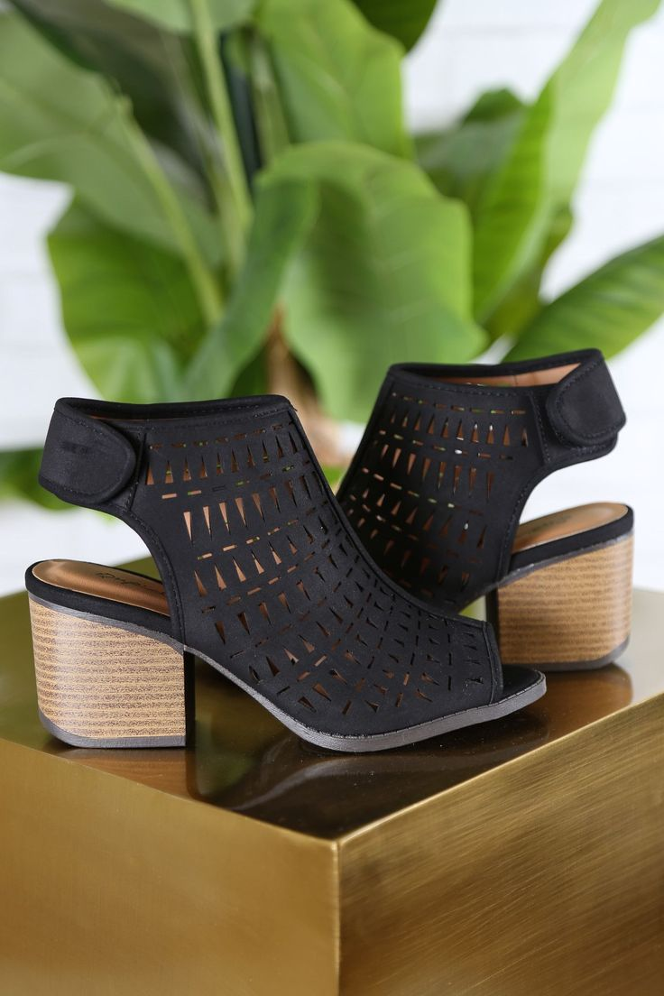 Black laser cut open toe booties with velcro closure. Super comfortable with a low heel!