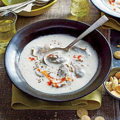 Classic Oyster Stew | There are countless versions of this simple, elegant stew. To achieve the perfect texture of just-cooked oysters, poach them in the milk until their edges begin to curl, set aside, and return them to the stew just before serving.