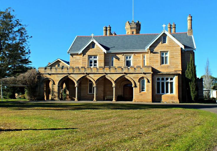 """Parkhall"", Douglas Park NSW. A two storey Gothic Revival sandstone house (c. 1842-4) built for the Surveyor General Sir Thomas Livingston Mitchell, to a design from Francis Goodwin's 'Rural Architecture' and supervised by James Hume. There is a fine geometrical stone stair with cast iron balusters, several original chimney pieces, and Mitchell Arms on the eastern gable. An arcade, tower and chapel were added sometime after 1860, Blacket being commissioned to add the arcade."