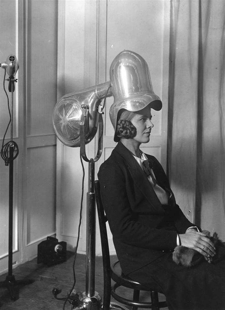 Early dryer  A model demonstrates the latest design in hair dryers in 1928. Before the hair dryer was made, people were using vacuum cleaners to dry their hair.