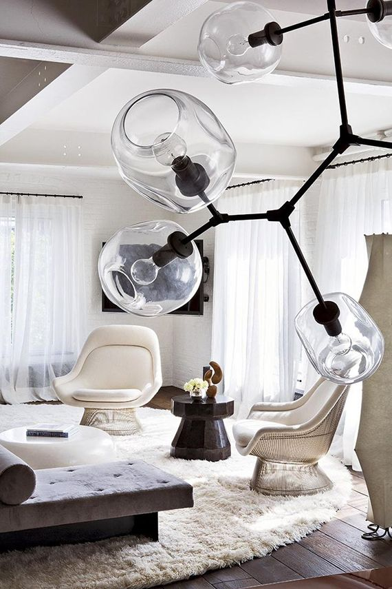 Modern branch chandeliers. Photo by Manolo Yllera via AD Espana