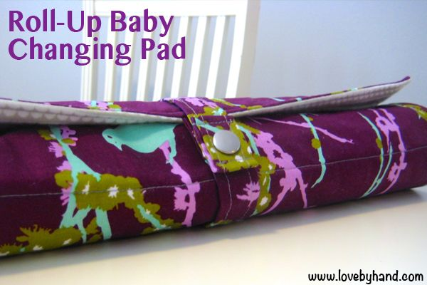 We all know how *fun* it is to travel with babies and toddlers {ok, all kids!} but Christen from the Creative Team is here to make your travels just a little easier. She's sharing an awesome tutorial on how to make a roll-up changing pad. This trav