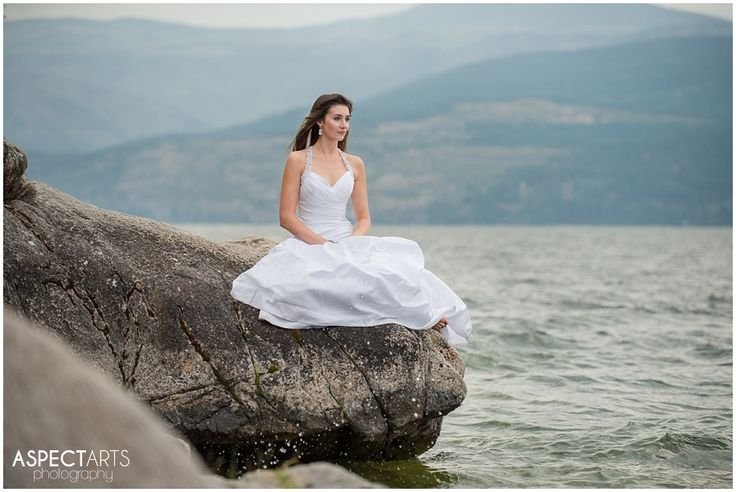 Okanagan Trash the Dress Vernon BC Rock the Frock session at Ellison Park.  The stunning bride sitting on a rock with water spray.  Kind of epic! #trashthedress #rockthefrock  www.aspectartsphoto.com