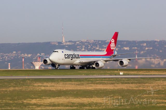 LX-VCB is taxiing back from RWY 31R on a sunny morning in Budapest. The city actually lies in the valley between the aircraft and the hills of Buda in the background where you can see the TV tower of Sz�chenyi hill...
