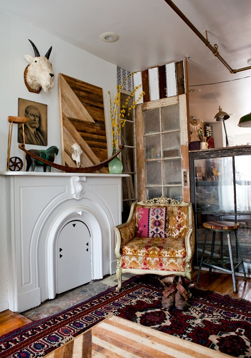 Love the mantel in Ariele Alasko's home. she DIY'ed that mountain goat.